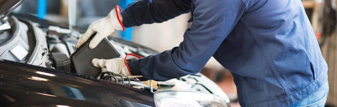 Repair Man Working on Engine